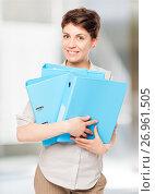 Купить «happy girl with blue folders for documents in the office», фото № 26961505, снято 6 августа 2017 г. (c) Константин Лабунский / Фотобанк Лори