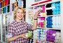Mature glad woman customer picking various yarn, фото № 26961737, снято 20 сентября 2017 г. (c) Яков Филимонов / Фотобанк Лори