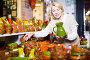 Happy mature female choosing pottery cookware, фото № 26961805, снято 31 октября 2016 г. (c) Яков Филимонов / Фотобанк Лори