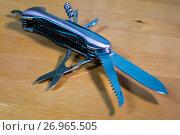 Купить «Pocket penknife with the displayed edges and tools on a wooden table», фото № 26965505, снято 14 февраля 2016 г. (c) Куликов Константин / Фотобанк Лори