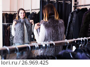 Купить «Girl choosing fur vest», фото № 26969425, снято 20 мая 2019 г. (c) Яков Филимонов / Фотобанк Лори