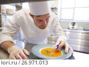 Купить «happy male chef cooking food at restaurant kitchen», фото № 26971013, снято 2 апреля 2017 г. (c) Syda Productions / Фотобанк Лори