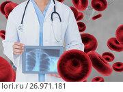 Купить «Doctor woman holding a radiograph with 3D cells against grey background», фото № 26971181, снято 21 апреля 2018 г. (c) Wavebreak Media / Фотобанк Лори