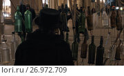 Купить «Musical performance with glass bottles», видеоролик № 26972709, снято 7 января 2017 г. (c) Данил Руденко / Фотобанк Лори