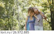 Купить «Father - bold man, mother - blonde beautiful woman and little girl - walking in the park at sunny day», фото № 26972885, снято 27 апреля 2018 г. (c) Константин Шишкин / Фотобанк Лори