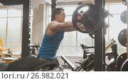 Купить «Fitness gym - muscular man performs squats with barbell», фото № 26982021, снято 22 мая 2018 г. (c) Константин Шишкин / Фотобанк Лори