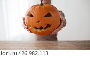 Купить «close up of woman with halloween pumpkin at home», видеоролик № 26982113, снято 20 сентября 2017 г. (c) Syda Productions / Фотобанк Лори