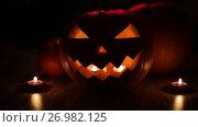 Купить «halloween jack-o-lantern burning in darkness», видеоролик № 26982125, снято 20 сентября 2017 г. (c) Syda Productions / Фотобанк Лори