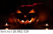 Купить «halloween jack-o-lantern burning in darkness», видеоролик № 26982129, снято 20 сентября 2017 г. (c) Syda Productions / Фотобанк Лори