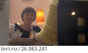 Купить «Women relaxing and talking in cafe», видеоролик № 26983241, снято 18 ноября 2018 г. (c) Данил Руденко / Фотобанк Лори