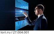 Купить «businessman with stock charts on virtual screens», фото № 27004001, снято 9 марта 2017 г. (c) Syda Productions / Фотобанк Лори