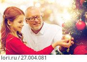Купить «grandfather and granddaughter at christmas tree», фото № 27004081, снято 14 сентября 2014 г. (c) Syda Productions / Фотобанк Лори