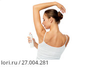 Купить «woman with antiperspirant deodorant over white», фото № 27004281, снято 9 апреля 2017 г. (c) Syda Productions / Фотобанк Лори