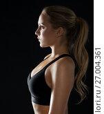 Купить «young woman in black sportswear posing in gym», фото № 27004361, снято 26 апреля 2017 г. (c) Syda Productions / Фотобанк Лори