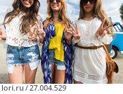 Купить «smiling young hippie women showing peace sign», фото № 27004529, снято 27 августа 2015 г. (c) Syda Productions / Фотобанк Лори