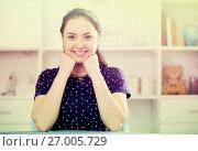 Купить «Positive brown-eyed girl at table», фото № 27005729, снято 9 апреля 2017 г. (c) Яков Филимонов / Фотобанк Лори