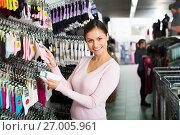 Купить «Woman shopping socks in leg-wear», фото № 27005961, снято 15 августа 2018 г. (c) Яков Филимонов / Фотобанк Лори