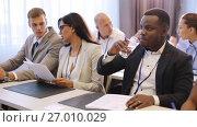 Купить «happy business team at international conference», видеоролик № 27010029, снято 27 февраля 2020 г. (c) Syda Productions / Фотобанк Лори