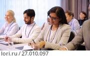 Купить «happy business team at international conference», видеоролик № 27010097, снято 22 января 2020 г. (c) Syda Productions / Фотобанк Лори