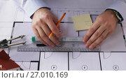 Купить «architect hands with ruler measuring blueprint», видеоролик № 27010169, снято 7 сентября 2017 г. (c) Syda Productions / Фотобанк Лори