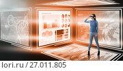 Купить «Composite image of full length of experiencing virtual reality simulator», фото № 27011805, снято 26 мая 2019 г. (c) Wavebreak Media / Фотобанк Лори