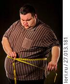 Купить «Man belly fat with tape measure weight loss around body .», фото № 27013181, снято 24 марта 2017 г. (c) Gennadiy Poznyakov / Фотобанк Лори
