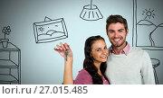 Купить «Couple Holding key with house home drawings in front of vignette», фото № 27015485, снято 23 августа 2019 г. (c) Wavebreak Media / Фотобанк Лори