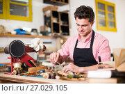 Купить «Carpenter working in studio», фото № 27029105, снято 8 апреля 2017 г. (c) Яков Филимонов / Фотобанк Лори