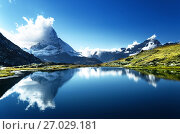 Купить «Reflection of Matterhorn in lake, Zermatt, Switzerland», фото № 27029181, снято 11 сентября 2017 г. (c) Iakov Kalinin / Фотобанк Лори