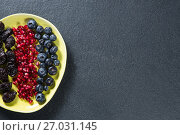 Купить «Overhead view of various fruits in plate on slate», фото № 27031145, снято 12 июня 2017 г. (c) Wavebreak Media / Фотобанк Лори