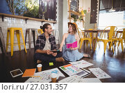 Купить «Cheerful young professionals sitting with sheets on floor», фото № 27031357, снято 21 мая 2017 г. (c) Wavebreak Media / Фотобанк Лори