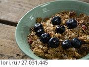 Купить «Oats with blueberries forming smiley face», фото № 27031445, снято 13 июня 2017 г. (c) Wavebreak Media / Фотобанк Лори