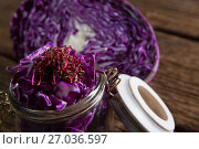 Купить «Chopped and halved red cabbage on wooden table», фото № 27036597, снято 12 июня 2017 г. (c) Wavebreak Media / Фотобанк Лори