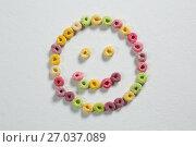 Купить «Froot loops forming a smiley face», фото № 27037089, снято 13 июня 2017 г. (c) Wavebreak Media / Фотобанк Лори