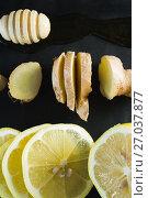 Купить «Lime, garlic and honey dipper in black slate plate», фото № 27037877, снято 5 июня 2017 г. (c) Wavebreak Media / Фотобанк Лори