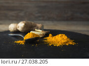 Купить «Turmeric powder and ginger on board», фото № 27038205, снято 5 июня 2017 г. (c) Wavebreak Media / Фотобанк Лори