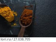 Купить «Turmeric powder and chili powder on wooden spoon», фото № 27038705, снято 5 июня 2017 г. (c) Wavebreak Media / Фотобанк Лори