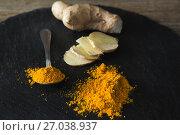 Купить «Turmeric powder and ginger on board», фото № 27038937, снято 5 июня 2017 г. (c) Wavebreak Media / Фотобанк Лори
