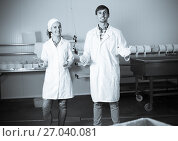 Купить «Happy young man and woman on the manufacture», фото № 27040081, снято 21 июля 2018 г. (c) Яков Филимонов / Фотобанк Лори