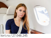 Купить «Young beautiful woman in Luxury interior in the business jet», фото № 27048245, снято 19 января 2019 г. (c) Mikhail Starodubov / Фотобанк Лори