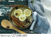 Купить «Various spices, spoon and napkin on wooden table», фото № 27048681, снято 5 июня 2017 г. (c) Wavebreak Media / Фотобанк Лори