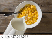 Купить «Milk being poured into bowl of wheaties cereal», фото № 27049549, снято 13 июня 2017 г. (c) Wavebreak Media / Фотобанк Лори