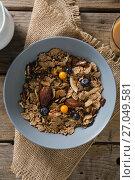 Купить «Wheat flakes with blueberry and golden berry in bowl», фото № 27049581, снято 13 июня 2017 г. (c) Wavebreak Media / Фотобанк Лори