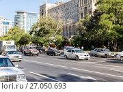 Купить «Baku, Azerbaijan - September 22, 2017: Movement of vehicles along the central street of Baku», фото № 27050693, снято 22 сентября 2017 г. (c) Евгений Ткачёв / Фотобанк Лори