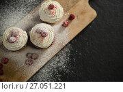 Купить «Overhead view of cupcakes on cutting board», фото № 27051221, снято 5 мая 2017 г. (c) Wavebreak Media / Фотобанк Лори