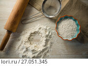 Купить «Overhead view of flour in bowl by rolling pin and strainer», фото № 27051345, снято 5 мая 2017 г. (c) Wavebreak Media / Фотобанк Лори