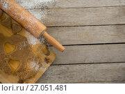 Купить «Overhead view of pastry dough on cutting board by rolling pin», фото № 27051481, снято 5 мая 2017 г. (c) Wavebreak Media / Фотобанк Лори