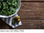 Купить «Mustard greens and gooseberry on wooden table», фото № 27052753, снято 12 июня 2017 г. (c) Wavebreak Media / Фотобанк Лори