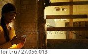 Купить «Woman using mobile phone in the stable 4k», видеоролик № 27056013, снято 15 октября 2018 г. (c) Wavebreak Media / Фотобанк Лори