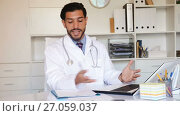 Купить «Spanish man doctor is working with documents behind laptop in his office.», видеоролик № 27059037, снято 9 августа 2017 г. (c) Яков Филимонов / Фотобанк Лори